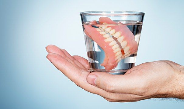 dentures in water glass