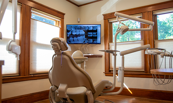 Woman in white shirt with dental pain