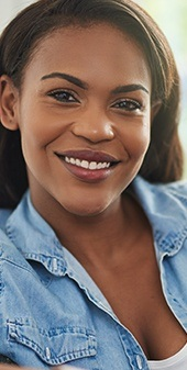 woman with straight smile smiling