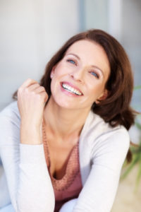 Laughing woman with brilliant smile thanks to teeth whitening