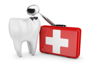white tooth beside red medical kit