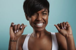 woman smiling flossing