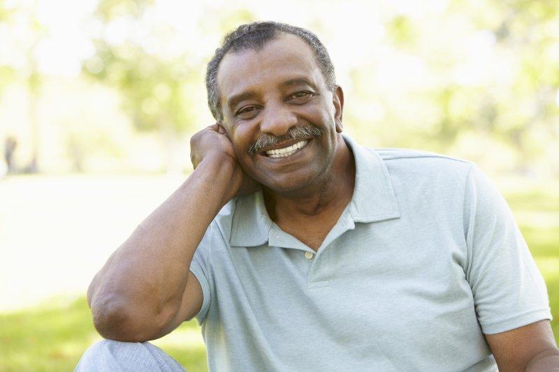 older man smiling grey hair